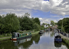 Narrow Boats on Canal. Narrow Boats moored on the Bridgewater Canal at Lymm, Cheshire, England Royalty Free Stock Photos