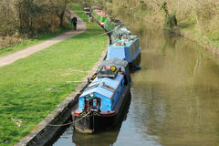 Narrow Boats on a Canal in Rural England. Narrow Boats on the Kennet and Avon Canal Near Bath in Somerset England Royalty Free Stock Photos