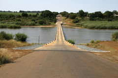 Narrow bridge over river. Narrow bridge over the Crocodile River in South Africa Stock Photo
