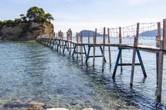 The narrow bridge to the wedding island Agios Sostis on Zakynthos, Greece stock image