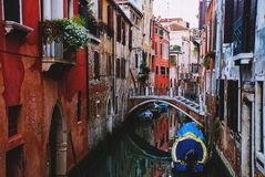 Narrow canal in the city of Venice