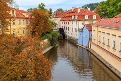 Narrow canal and colorful houses in Prague. Stock Photos
