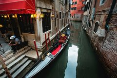 Narrow Canal with Gondola in Venice Royalty Free Stock Images
