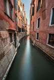 Narrow Canal Among Old Colorful Brick Houses Stock Photo