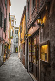 Narrow canal among old colorful brick houses in Venice Royalty Free Stock Image