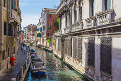 Narrow canal among old colorful brick houses in Venice Royalty Free Stock Images