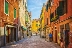 Narrow canal among old colorful brick houses in Venice Stock Photo