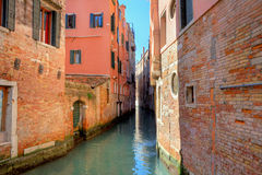Narrow canal among old houses in Venice, Italy. Stock Image