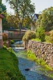 Narrow canal in old town Kuldiga, Latvia Stock Photography