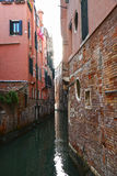 Narrow canal in a summer day in Venice, Italy Stock Images