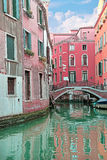 Narrow canal in a summer day in Venice, Italy Stock Image
