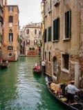 Narrow canal with traditional gondolas in Venice, Italy stock photo