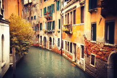 Narrow canal in Venice at autumn Royalty Free Stock Images