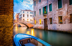 Narrow canal in Venice in the evening Stock Images