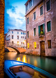Narrow canal in Venice in the evening Royalty Free Stock Photo