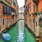 Narrow canal in Venice (Italy) Stock Photo
