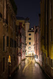 Narrow canal in Venice at night Stock Photography