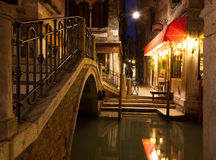 Narrow canal in Venice at night Stock Images
