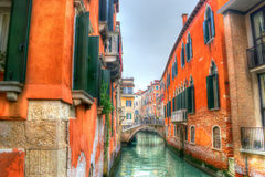 Narrow canal in Venice under a gray sky Royalty Free Stock Image