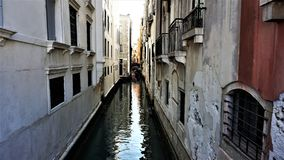 Narrow canal, between the whites and the kiln houses of Venice, Italy stock photography