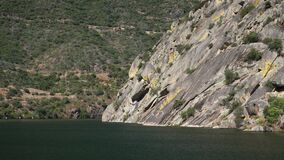 Narrow canyon with steep rocky sides on the river Douro in Northern Portugal on a cruise boat voyage