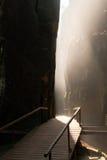 Narrow canyon walkway. Wooden walkway through a natural canyon Stock Photos