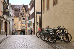 The narrow central pedestrian street with parked bicycle. Tubingen, Germany - April 17, 2016: The narrow central pedestrian street with old half-timbered houses Stock Photos