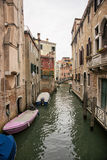 Narrow channel with citizen boats in Venice Royalty Free Stock Photo