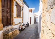 Narrow city street in Lindos Stock Photos