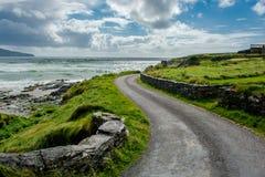Narrow Coastal Road in Ireland Stock Images