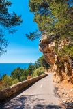 Narrow Coastal Road with Overhanging Rock in Mallorca Spain. Narrow Coastal Road with Overhanging Rock in Mallorca, Balearic Islands, Spain Royalty Free Stock Photos