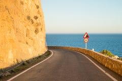 Narrow coastal road Stock Photography