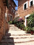 Narrow cobble stone street with plants in Fornalutx. Spain Royalty Free Stock Photography