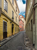 Narrow cobble street in Prague Royalty Free Stock Images