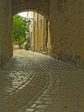 Narrow cobbled passageway. In Medieval town Royalty Free Stock Images