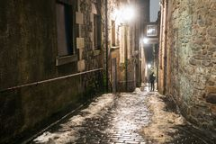 Narrow Cobbled Stairway between Old Stone Buildings at Night royalty free stock images