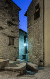 Narrow cobbled street in old town at night, France. Royalty Free Stock Images
