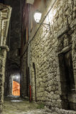 Narrow cobbled street in old town at night, France. royalty free stock image