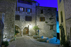 Narrow cobbled street in old town Peille at night Royalty Free Stock Images