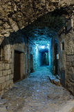 Narrow cobbled street in old town Peille at night, . Stock Photo