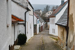 Narrow cobbled street in old village of Germany. The characteristic architecture and infrastructure of a rural residential area in Wemding, Germany, with a man Stock Images