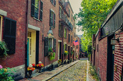 Narrow Cobbled Street and Red-Brick Houses in Boston Stock Photo