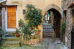 Narrow cobbled streets with flowers in the old village Lyuseram Royalty Free Stock Photo