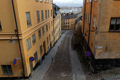 Narrow cobblestone alley and old houses in central Stockholm Stock Image
