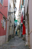 Cobblestone Alfama street with laundry hanging Royalty Free Stock Image