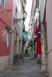 Cobblestone Alfama street with laundry hanging Royalty Free Stock Image