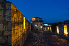 Narrow cobblestone path with an old fashioned lanterns inside Kalemegdan fortress at blue hour, Belgrade Stock Images