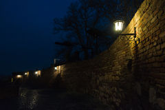 Narrow cobblestone path with an old fashioned lanterns inside Kalemegdan fortress at blue hour, Belgrade Royalty Free Stock Image