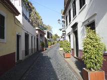 Narrow cobblestone paved street in Funchal. Madeira stock photo