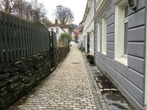 A narrow cobblestone street in Bergen, Norway. Stock Images